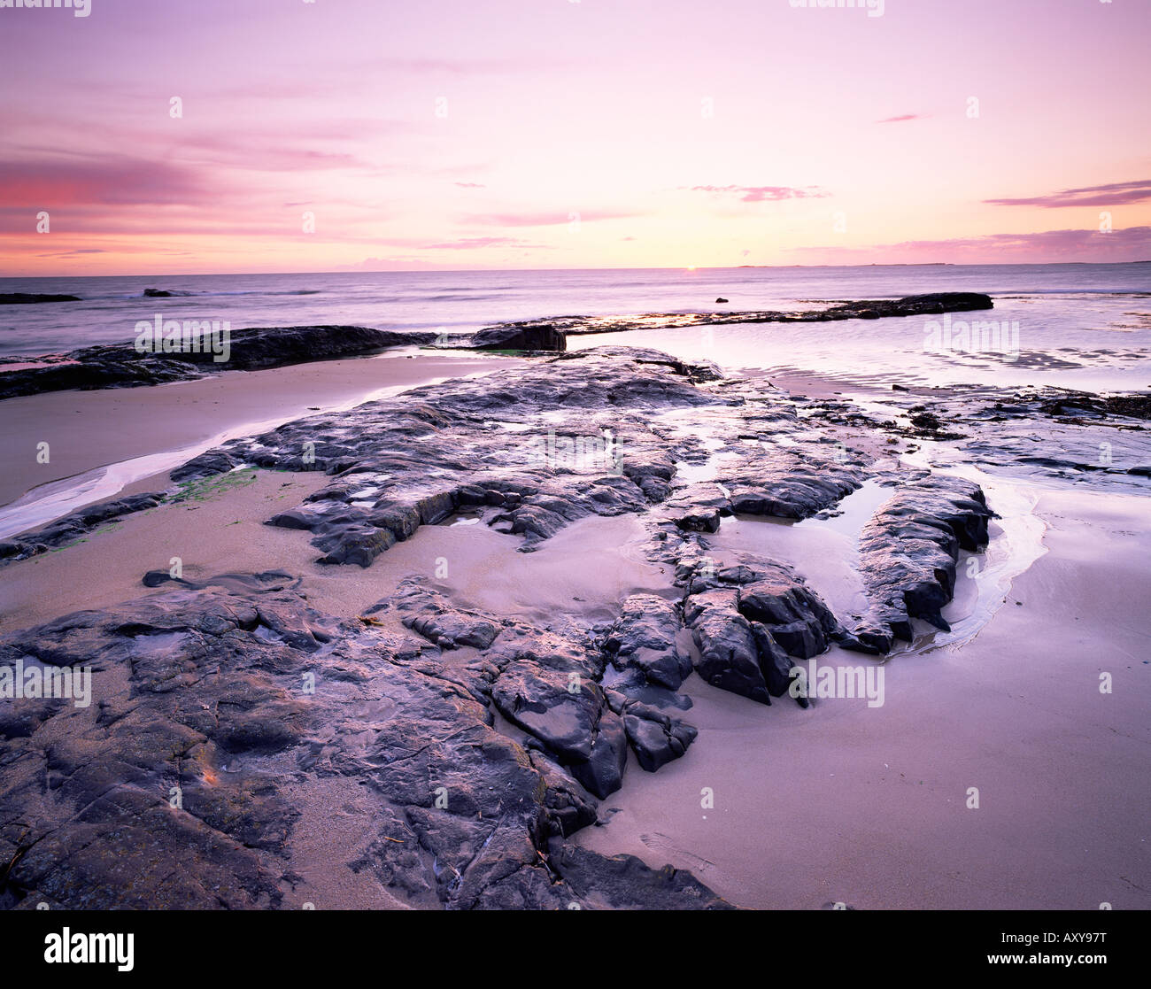 Sunrise over North Sea from Bamburgh beach, Bamburgh, Northumberland, England, United Kingdom, Europe - Stock Image
