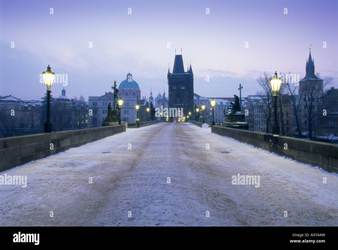 Charles Bridge in winter snow, Prague, UNESCO World Heritage Site, Czech Republic, Europe - Stock Image