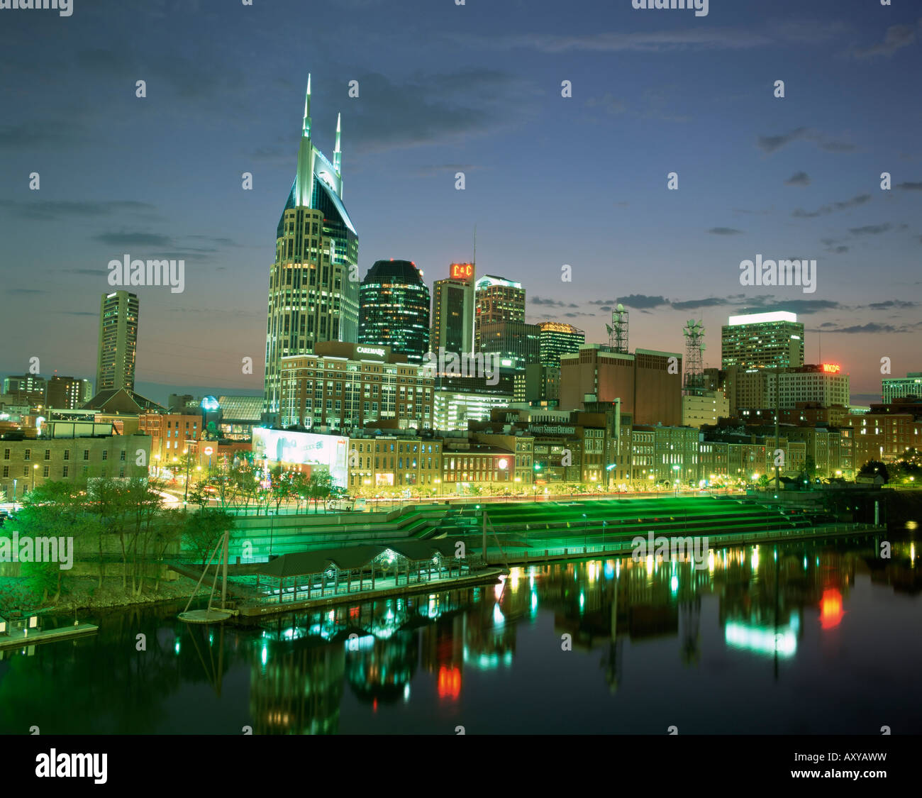 City skyline and Cumberland river at dusk, Riverfront Park, Nashville, Tennessee, United States of America, North - Stock Image
