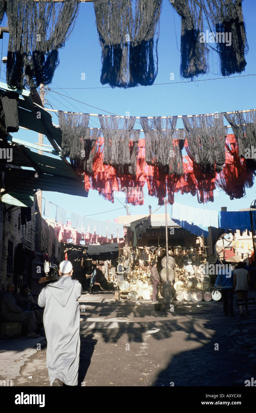 Skeins and cloth hanging in the souk, Marrakech, Morocco, North Africa, Africa - Stock Image