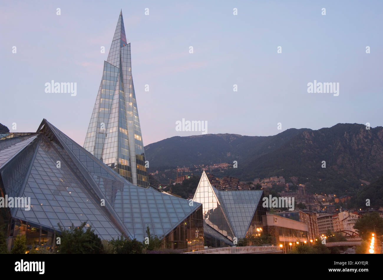Caldea Hot Spring Complex lit up in the evening, Andorra La Vella, Andorra, Europe - Stock Image
