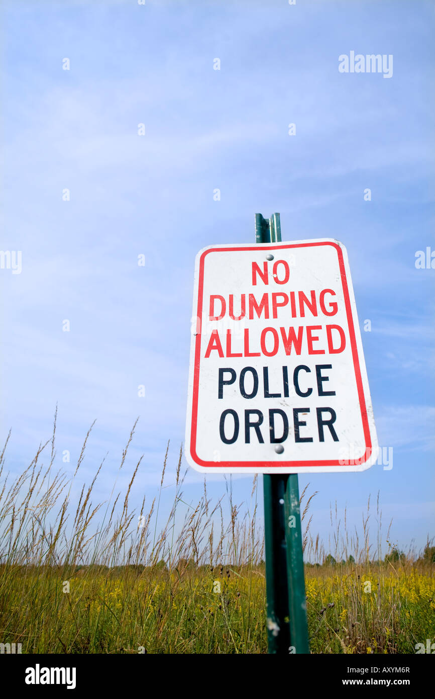 No Dumping Allowed Police Order Sign in prairie grasses - Stock Image