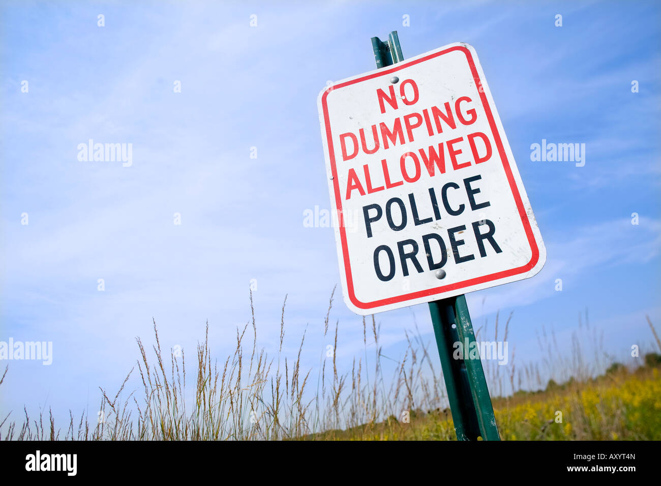 No Dumping Allowed Police Order Sign in prairie grasses Stock Photo
