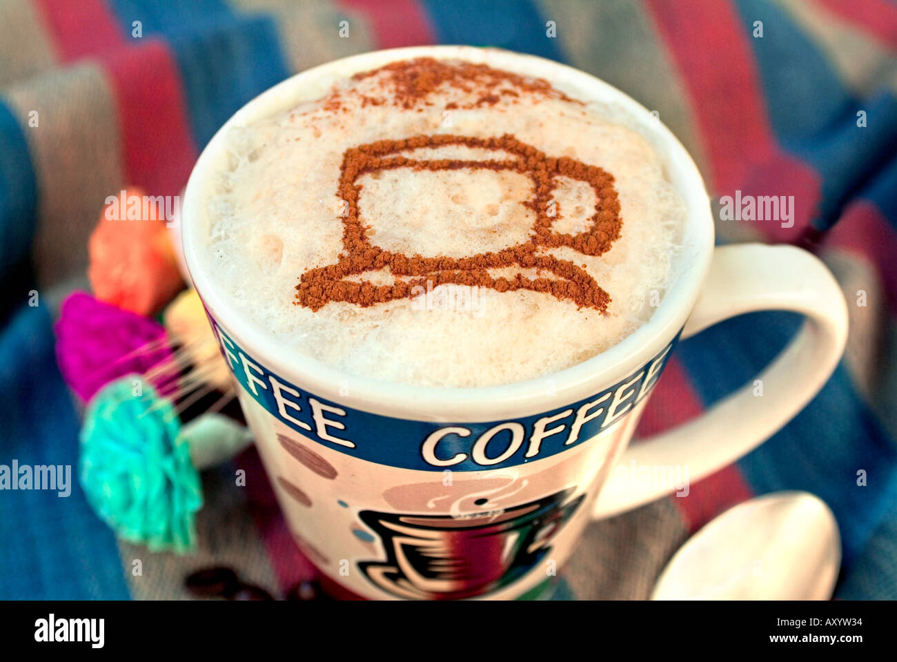 05159480f15 Latte with coffee cup design made of cinnamon on top of froth - Stock Image