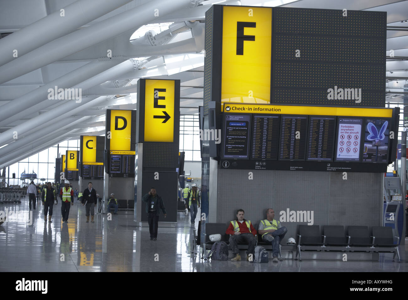 Flight departures information boards in landside Departures area newly opened London Heathrow Airport's Terminal - Stock Image