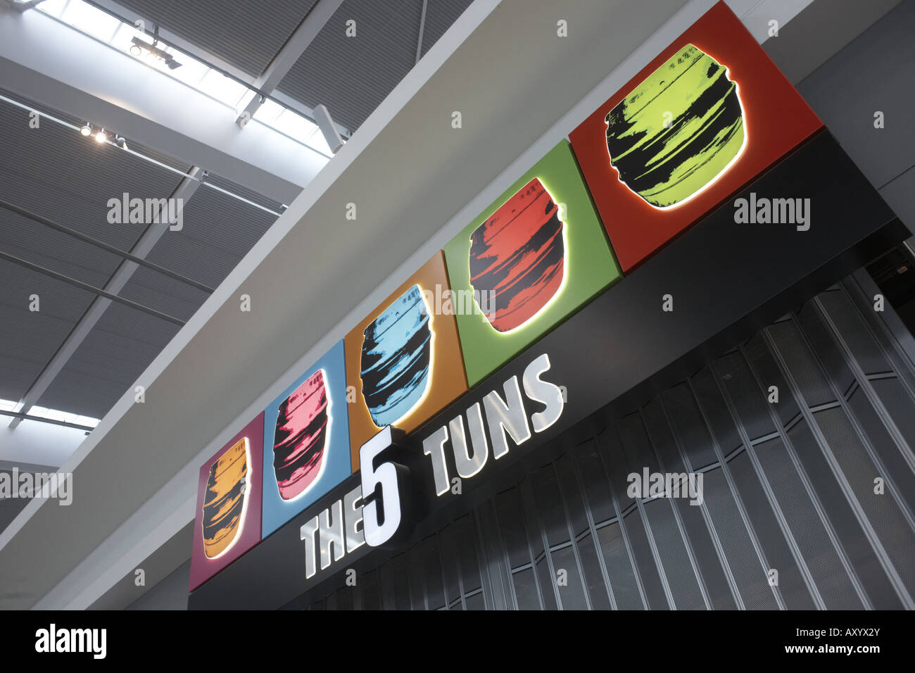 Looking upwards to the '5 Tuns' retail sign in landside Departures area newly opened London Heathrow Airport's - Stock Image
