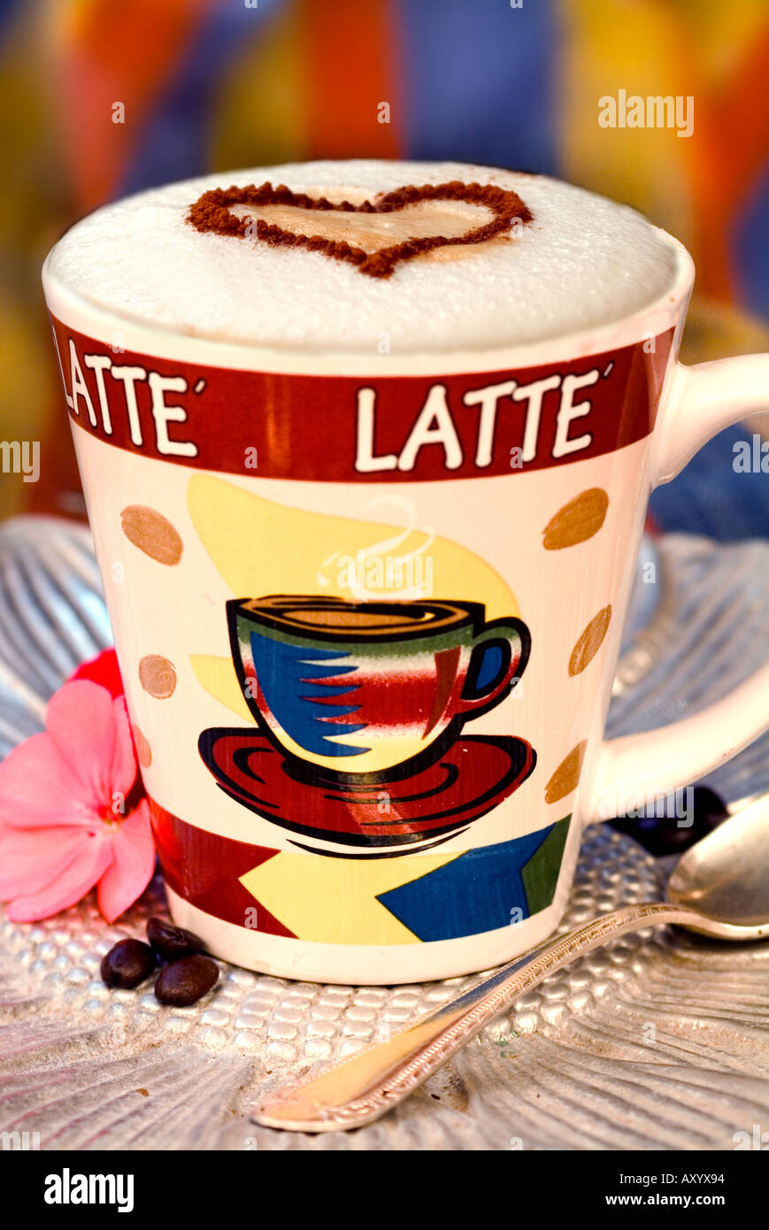 eb15fb67a0f Latte with heart shape design made of cinnamon on top of froth - Stock Image