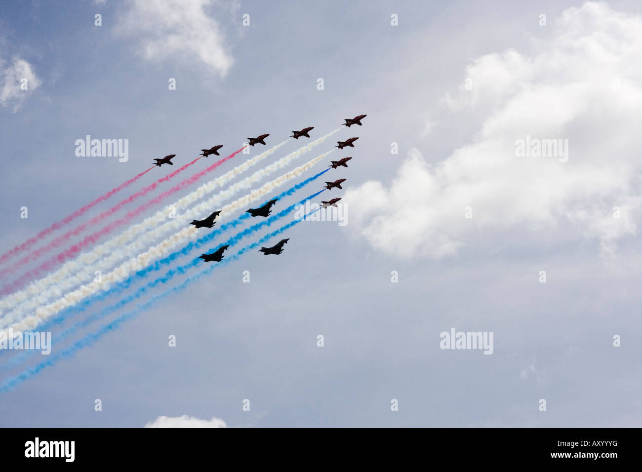 RAF Red Arrows formation aerobatic team flying in formation with 4 Typhoon aircraft over London to celebrate 90th - Stock Image