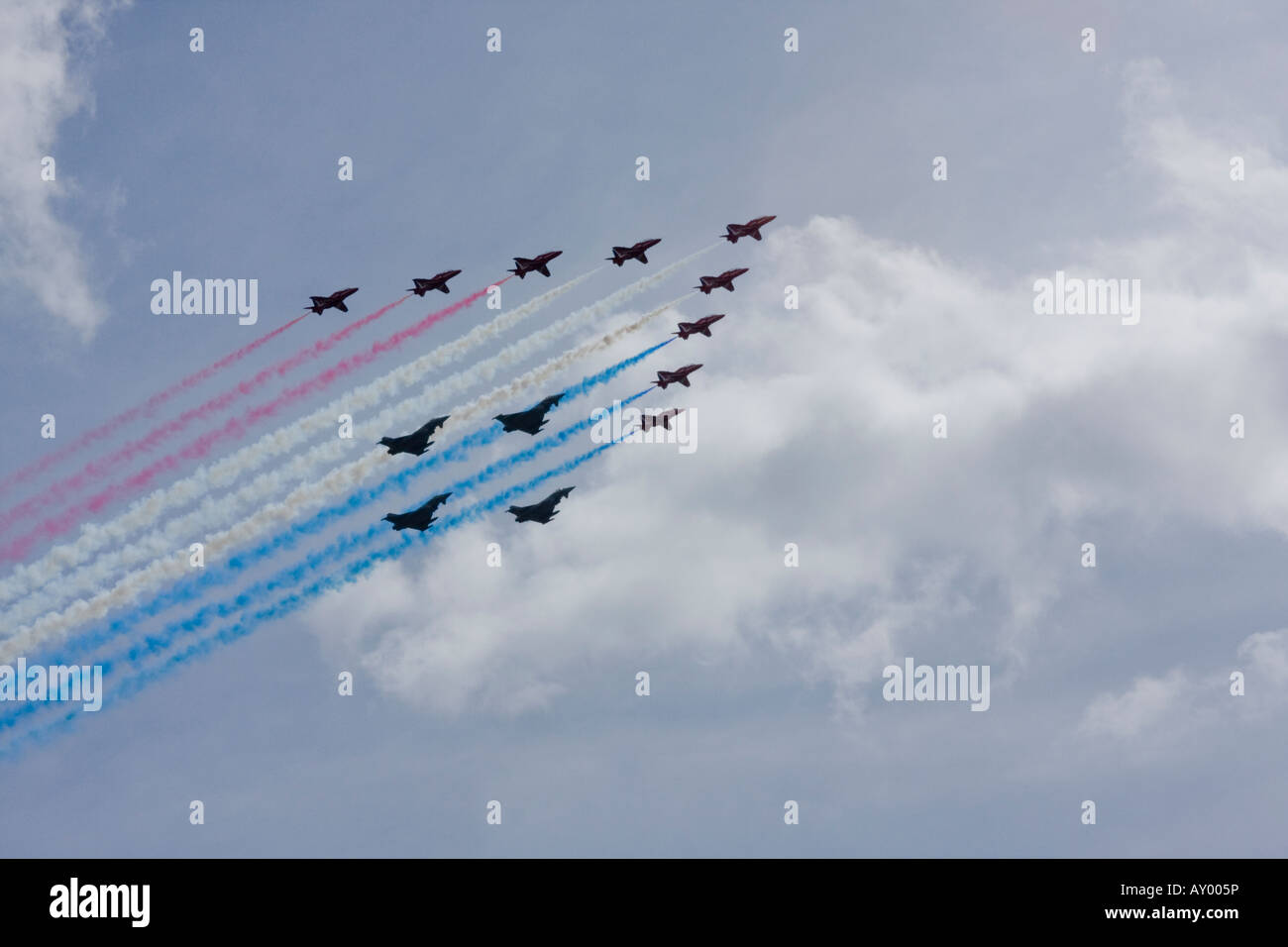 RAF Red Arrows formation aerobatic team flying in formation with four Typhoon aircraft over London to celebrate - Stock Image