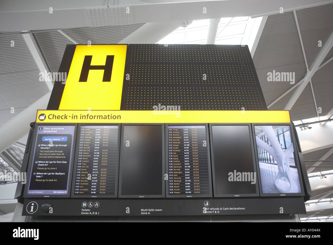 Landside flight departures information boards in newly-opened London Heathrow Airport's Terminal 5 building - Stock Image