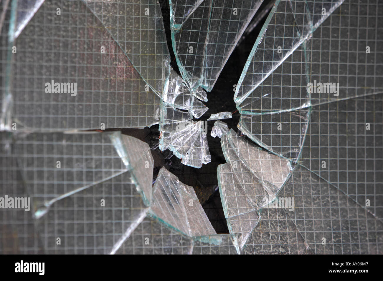 smashed reinforced glass window in Belfast City Centre - Stock Image
