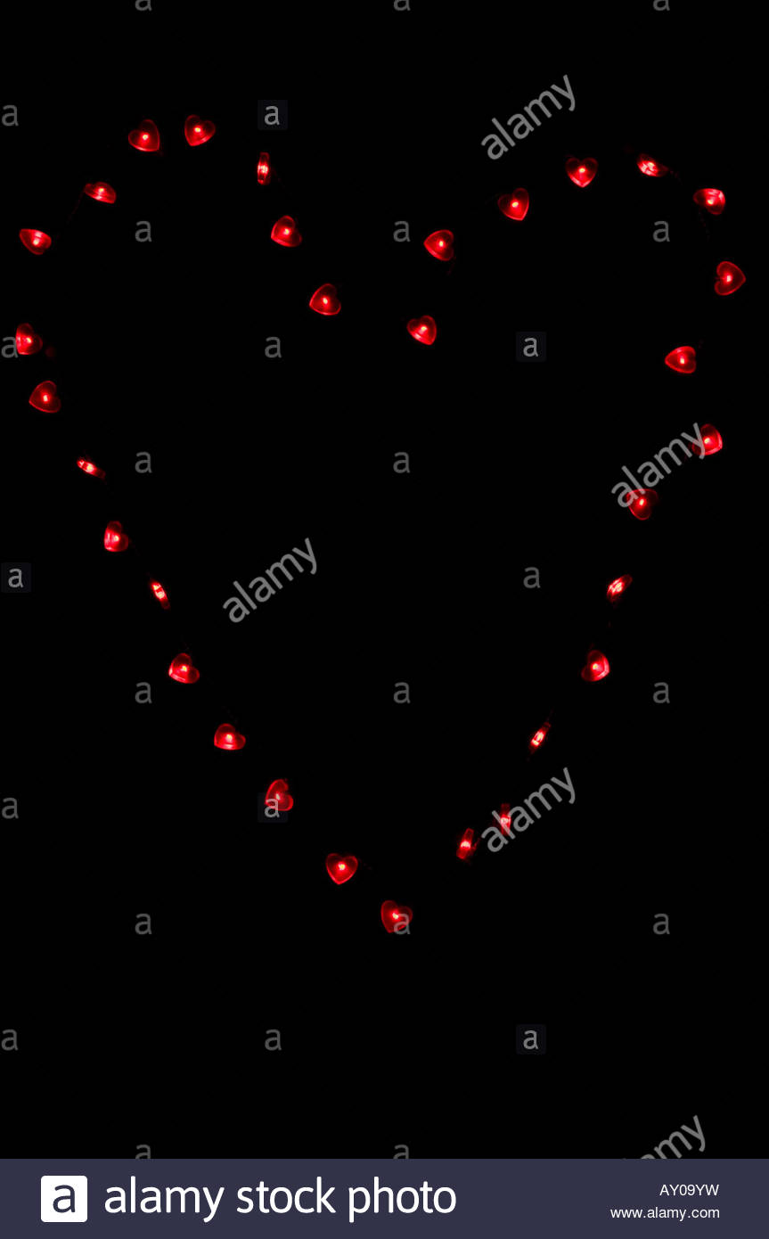 Large heart shape made of small heart shaped lights on black background Stock Photo