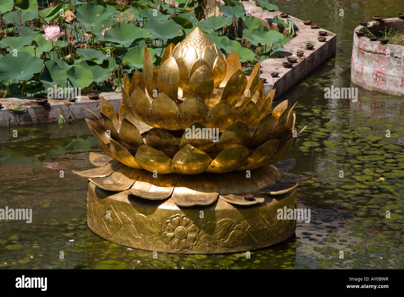 Large Golden Sculpture Of A Lotus Flower In A Pond Meenakshi Temple