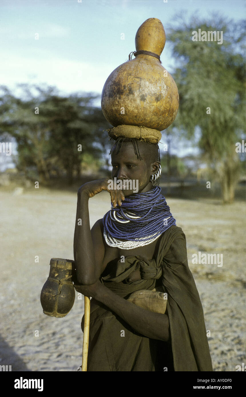 Turkana married woman carrying a gourd of water on her head Lokichar northern Kenya East Africa Stock Photo