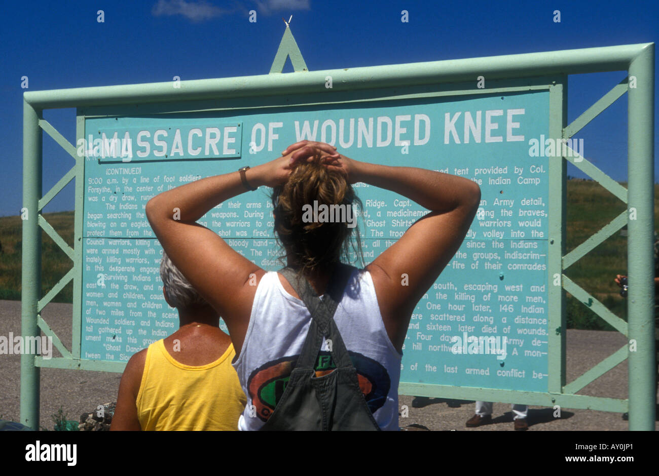 Tourist reading memorial to Massacre of Wounded Knee South Dakota USA Stock Photo