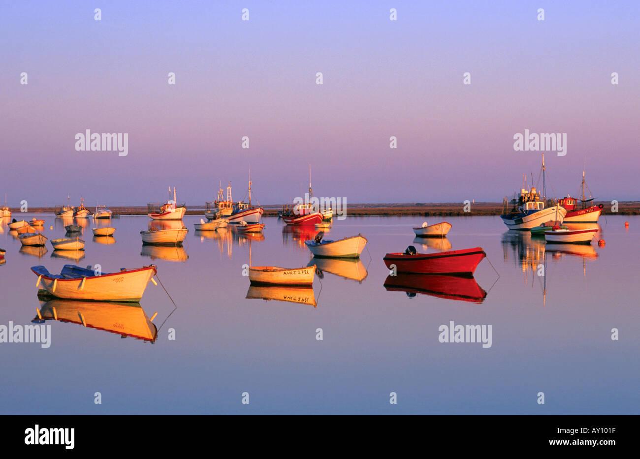 Boats on Ria formosa Santa Luzia Tavira Algarve Portugal Stock Photo