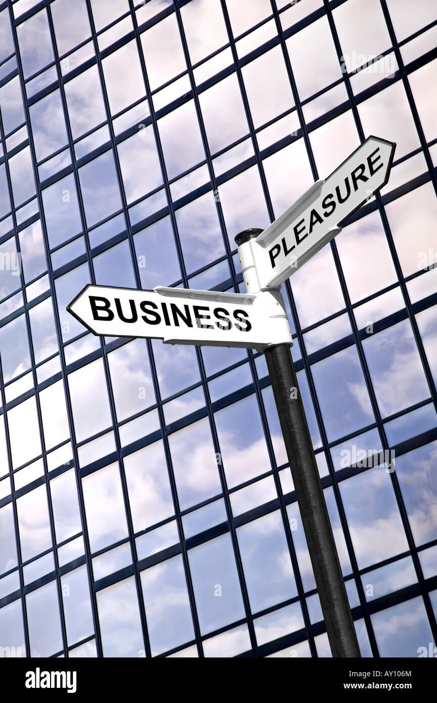Concept image of a signpost with the words Business or Pleasure against a modern glass office building - Stock Image