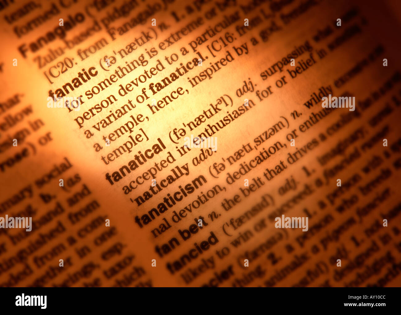 Awesome CLOSE UP OF DICTIONARY PAGE SHOWING DEFINITION OF THE WORDS FANATIC  FANATICAL