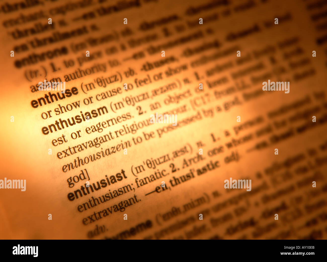 CLOSE UP OF DICTIONARY PAGE SHOWING DEFINITION OF THE WORD ENTHUSIASM