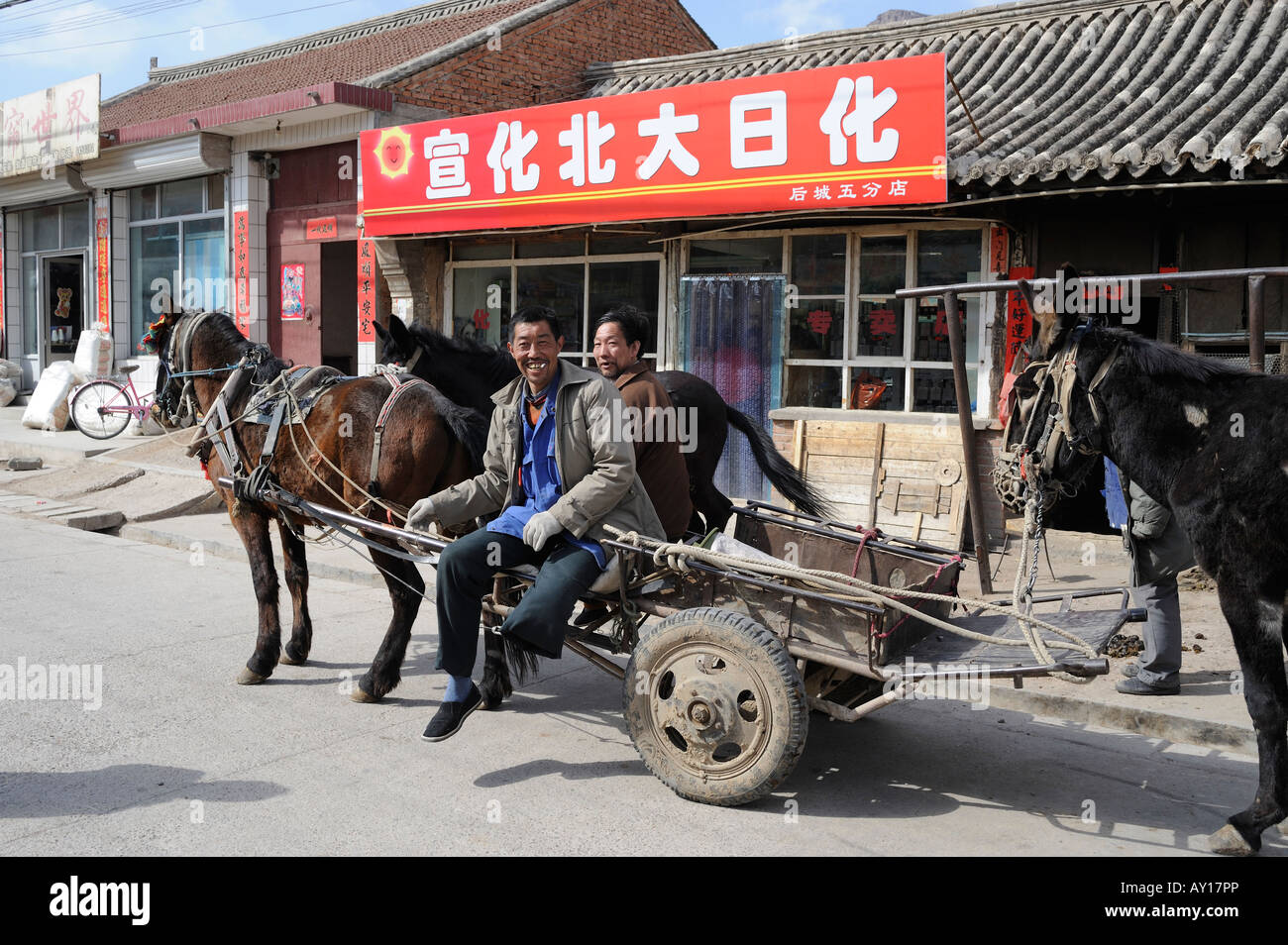 Farmers drives donkey cart in a town in Chicheng, Hebei, China. 27-Mar-2008 - Stock Image