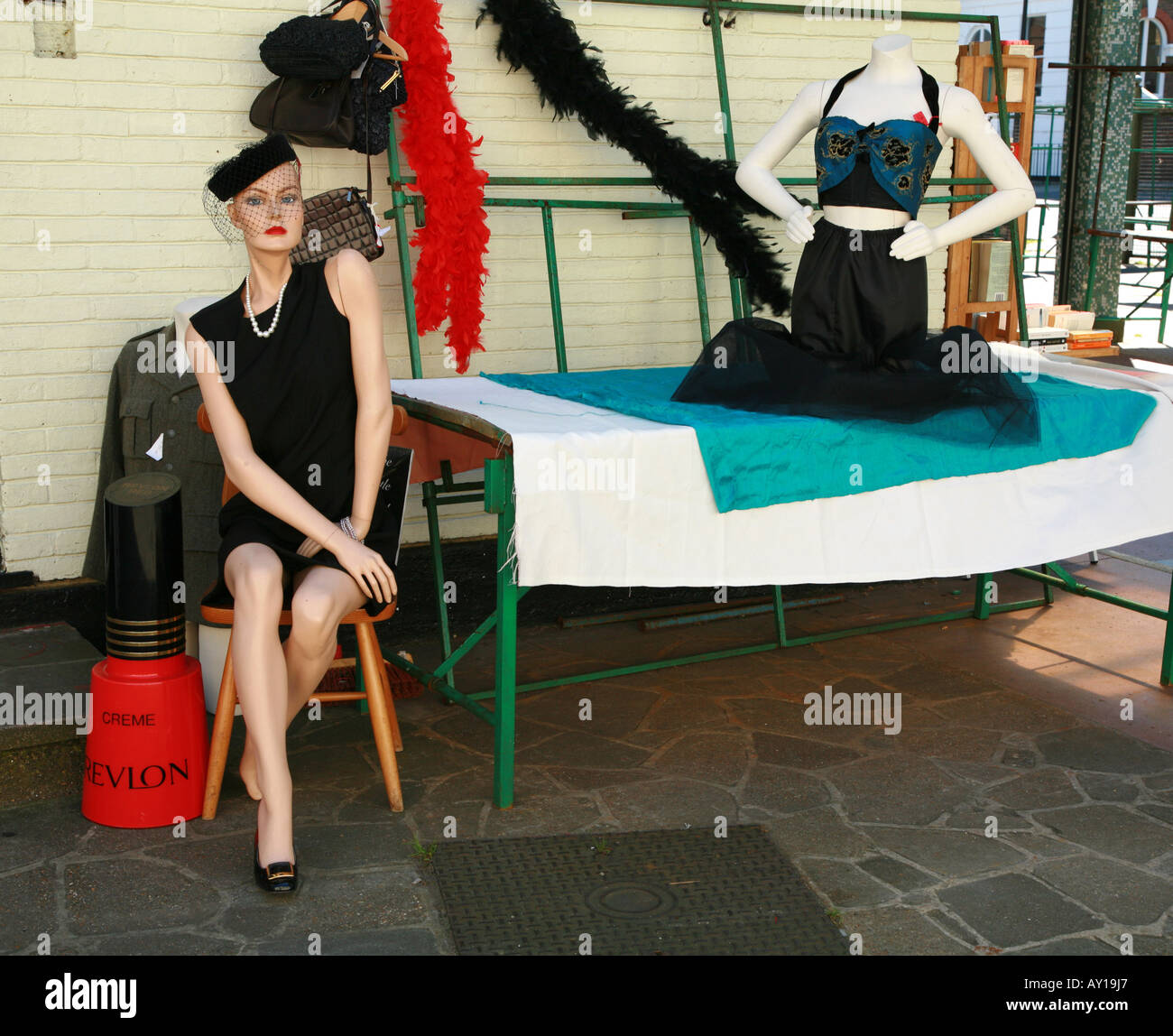 Glamorous model of a glam model  and her headless friend on Greenwich market - Stock Image