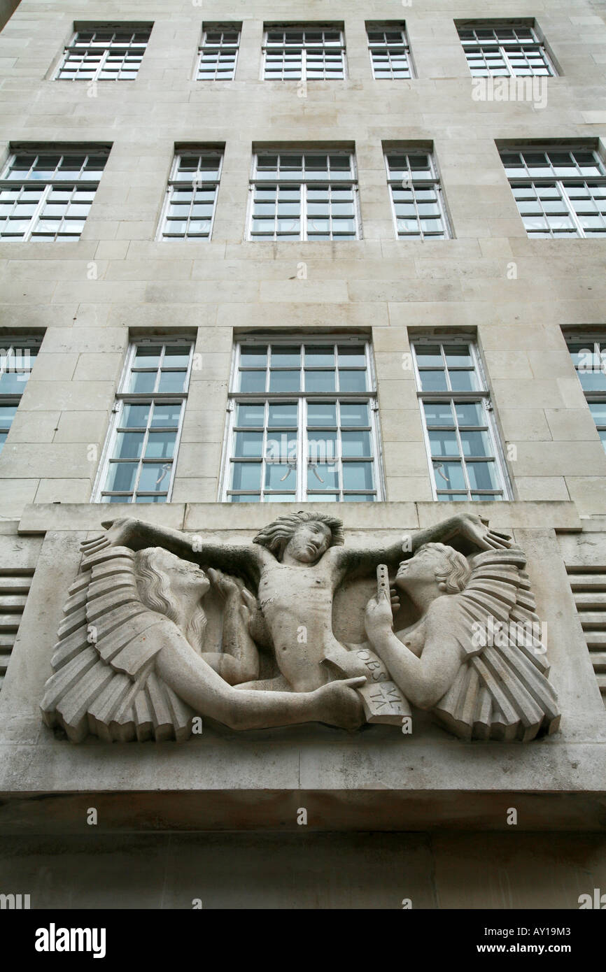 Bas relief of Ariel and two angels sculpted by Eric Gill on Broadcasting House in London - Stock Image
