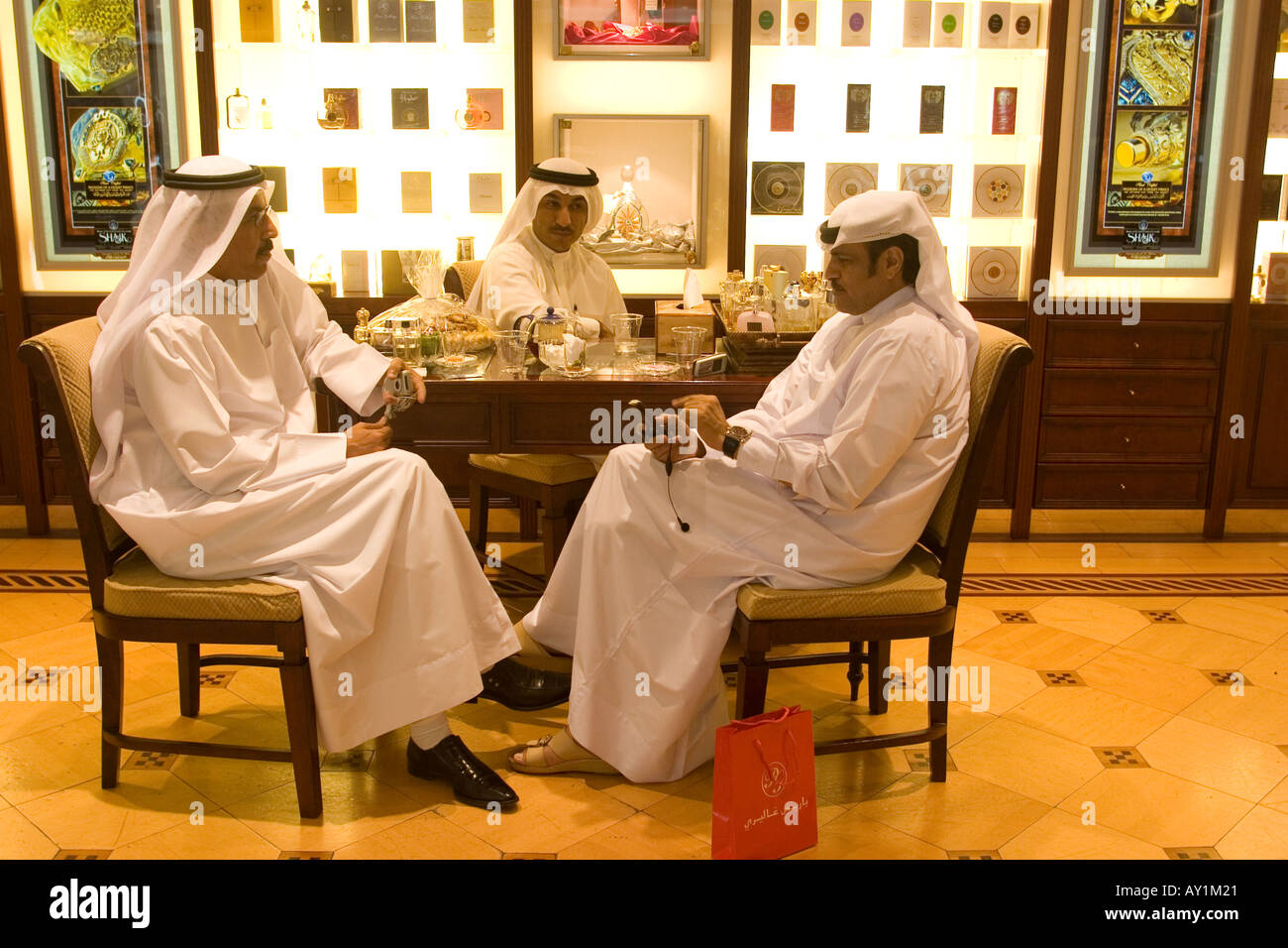 b3097e344 Arab men with traditional dress sitting at perfume shop in Deira city  centre shopping mall Dubai United Arab Emirates