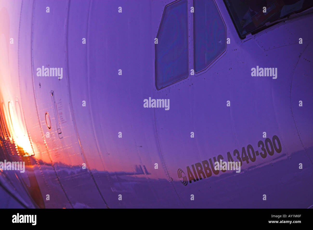 Airbus A340 airplane aeroplane civil aircraft jet passenger closeup close-up of front of aircraft in evening sunlight sunset - Stock Image