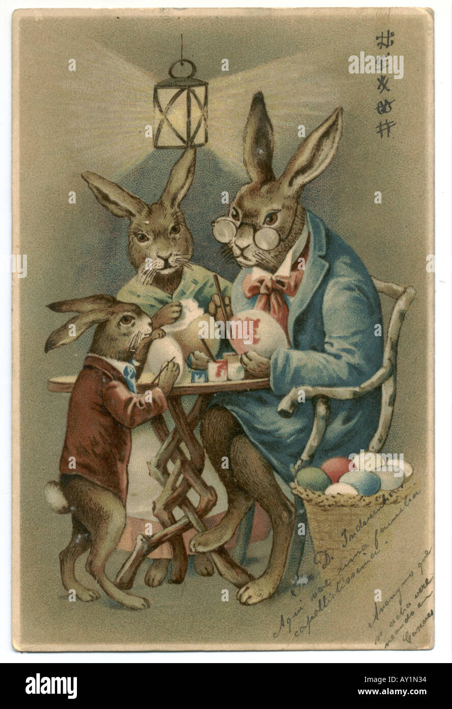 Russian Easter greeting card of hare family painting Easter eggs  1904 - Stock Image