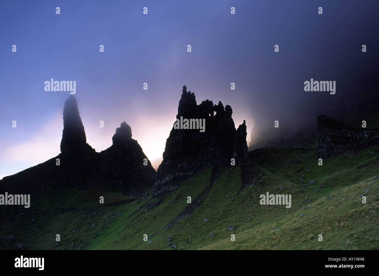 The Old Man of Storr being consumed by clouds at sunset on the Isle of Skye in Scotland UKStock Photo