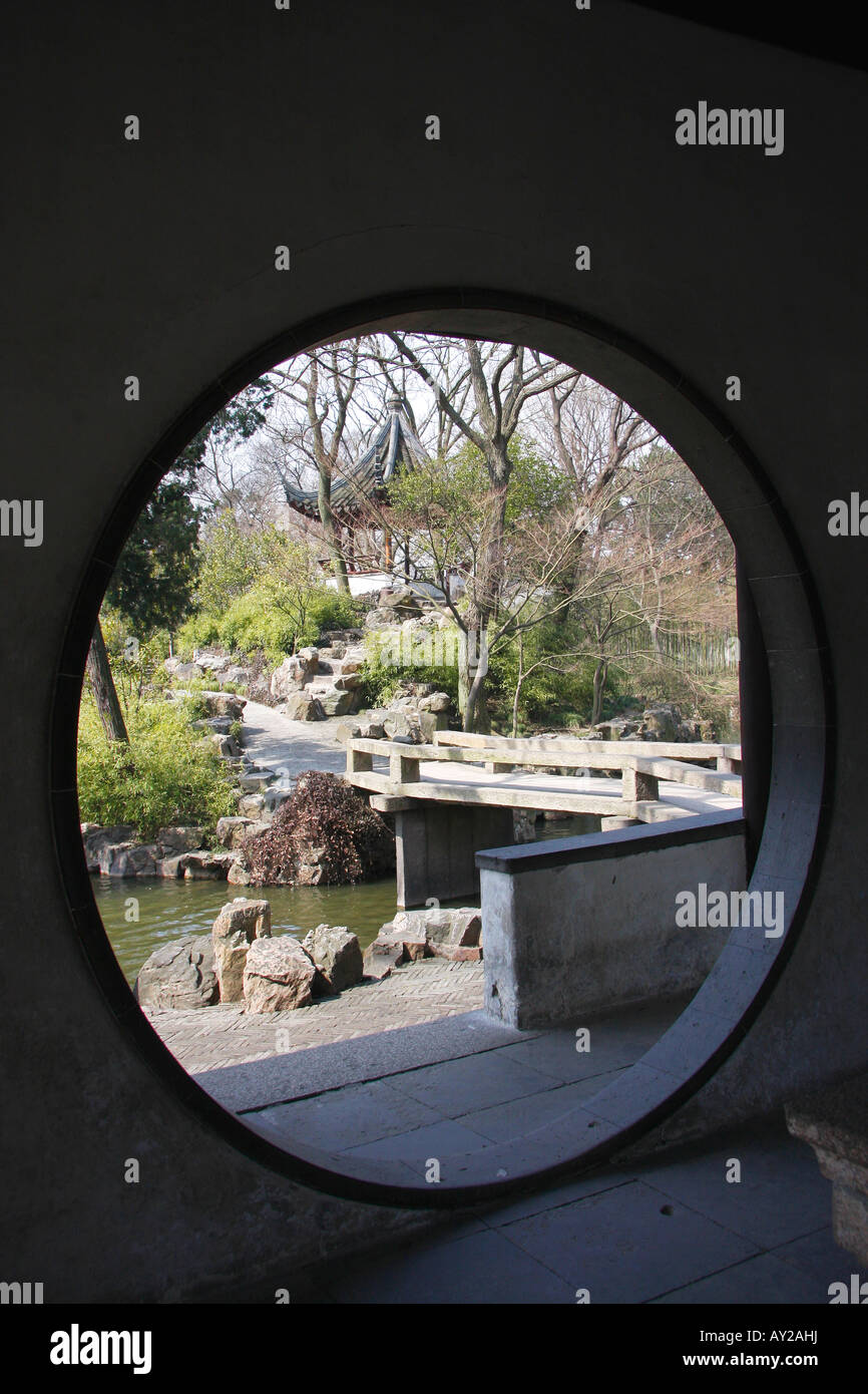 View of  a section of the Humble Administrators Garden through a 'Moon Gate. Suzhou,China. - Stock Image