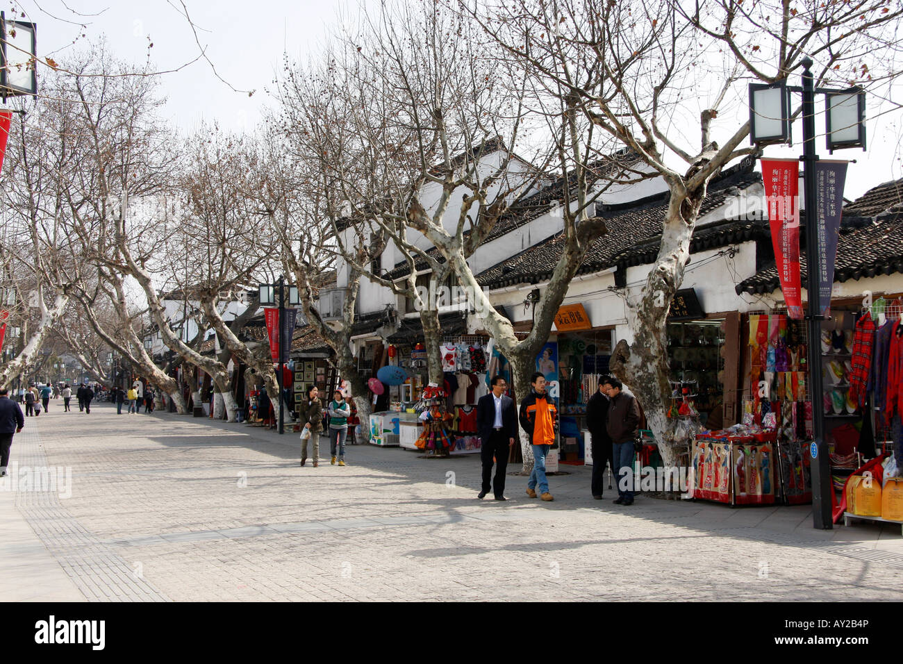 Street of  tourist shops at the entrance to the Humble Administrators Garden in Suzhou, China - Stock Image