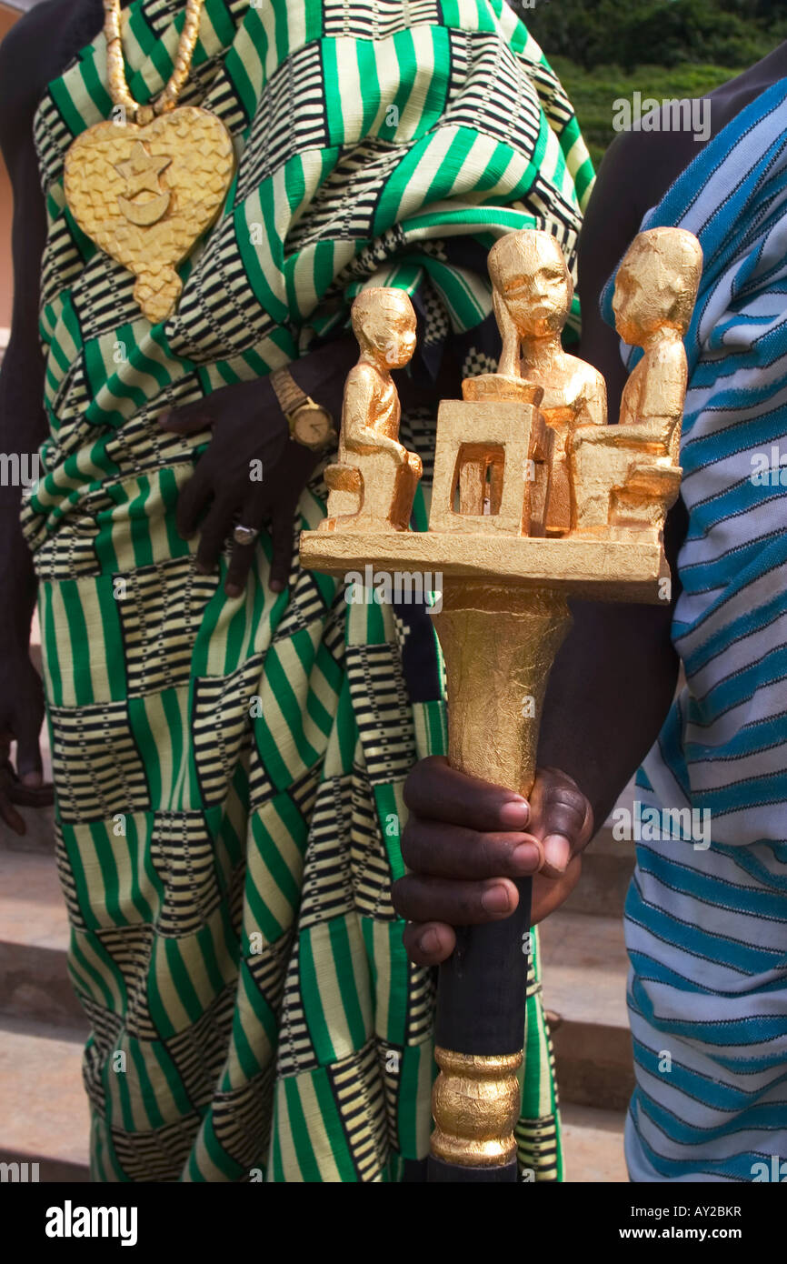 Detail of gold regalia worn by African village chief and golden staff held by chiefs linguist, Ghana - Stock Image