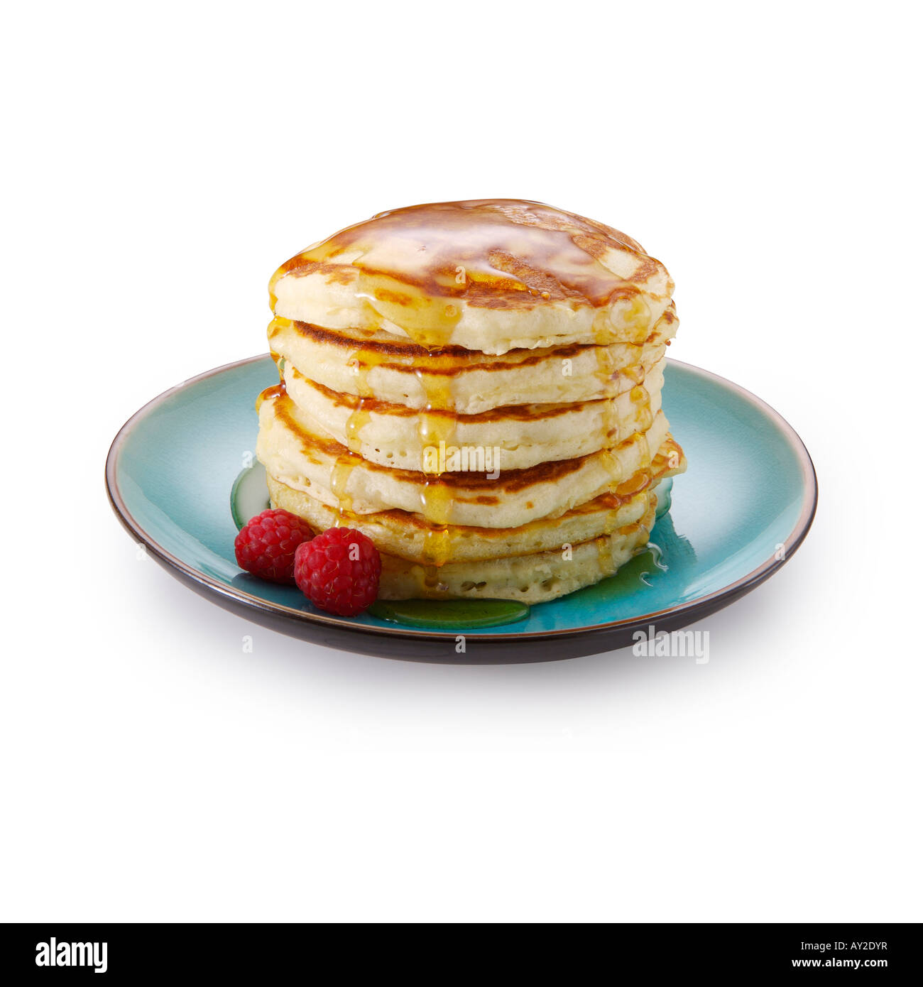 Pancakes with raspberries and maple syrup - Stock Image