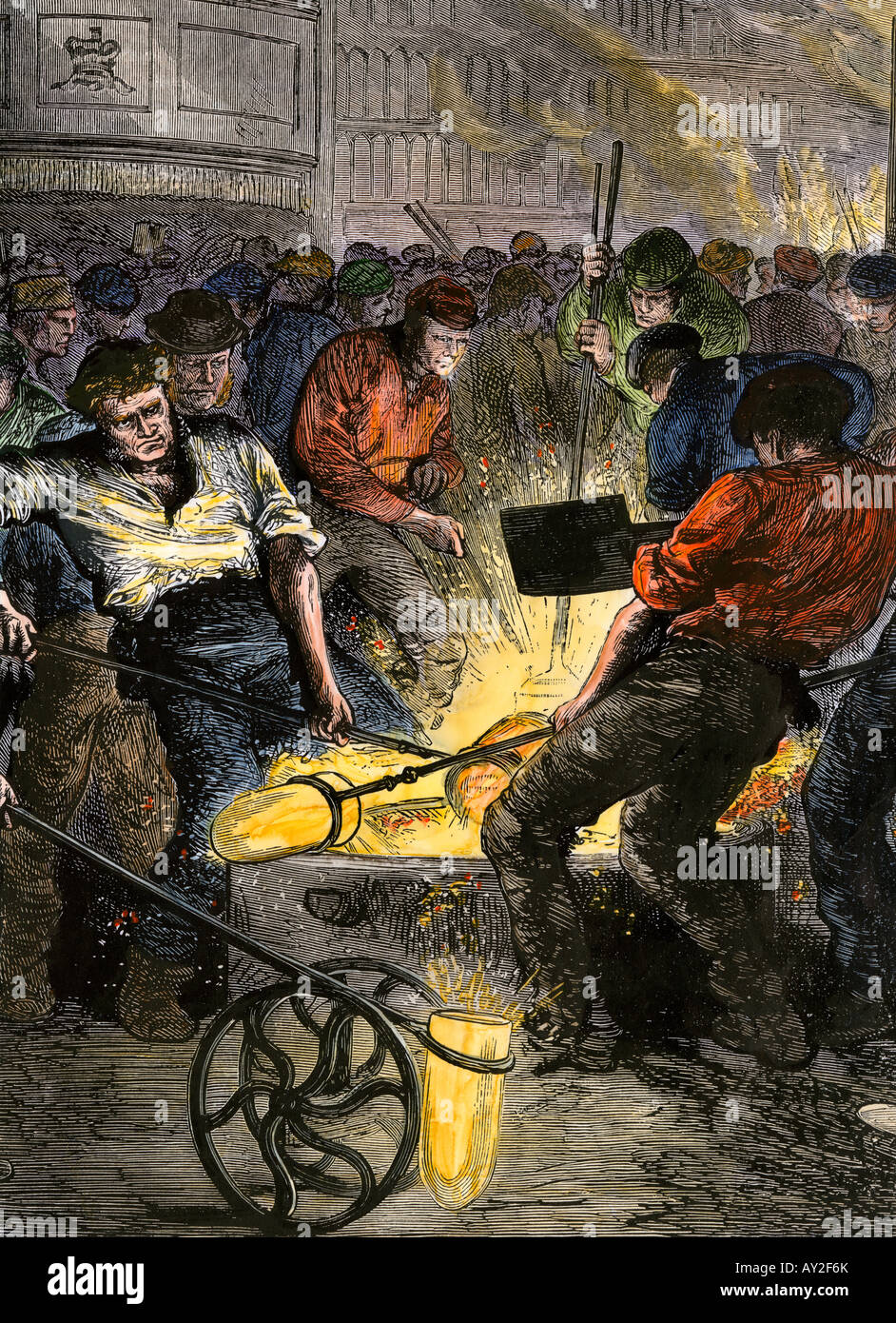 Workers manufacturing steel in England 1800s. Hand-colored woodcut Stock Photo