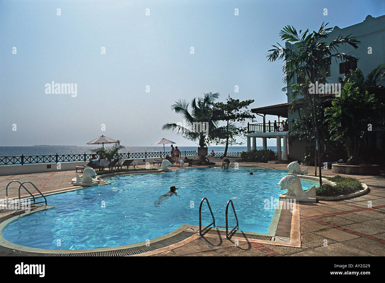 The swimming pool at the Serena a luxury hotel owned by the Aga Khan on Stone Town s historic waterfront Zanzibar Tanzania - Stock Image