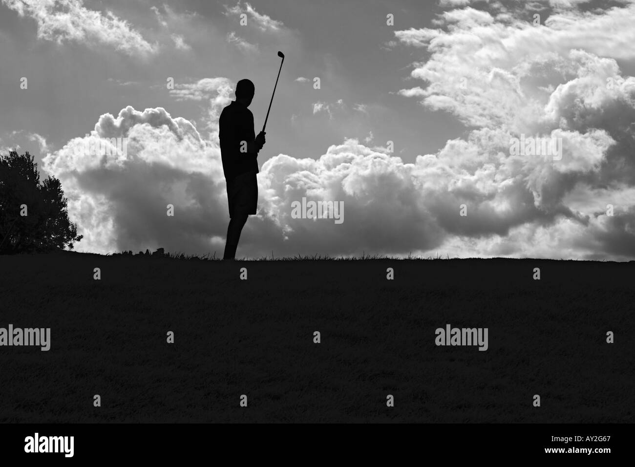 Man Playing Golf In Front Of Dramatic Cloudscape Sicily Italy - Stock Image