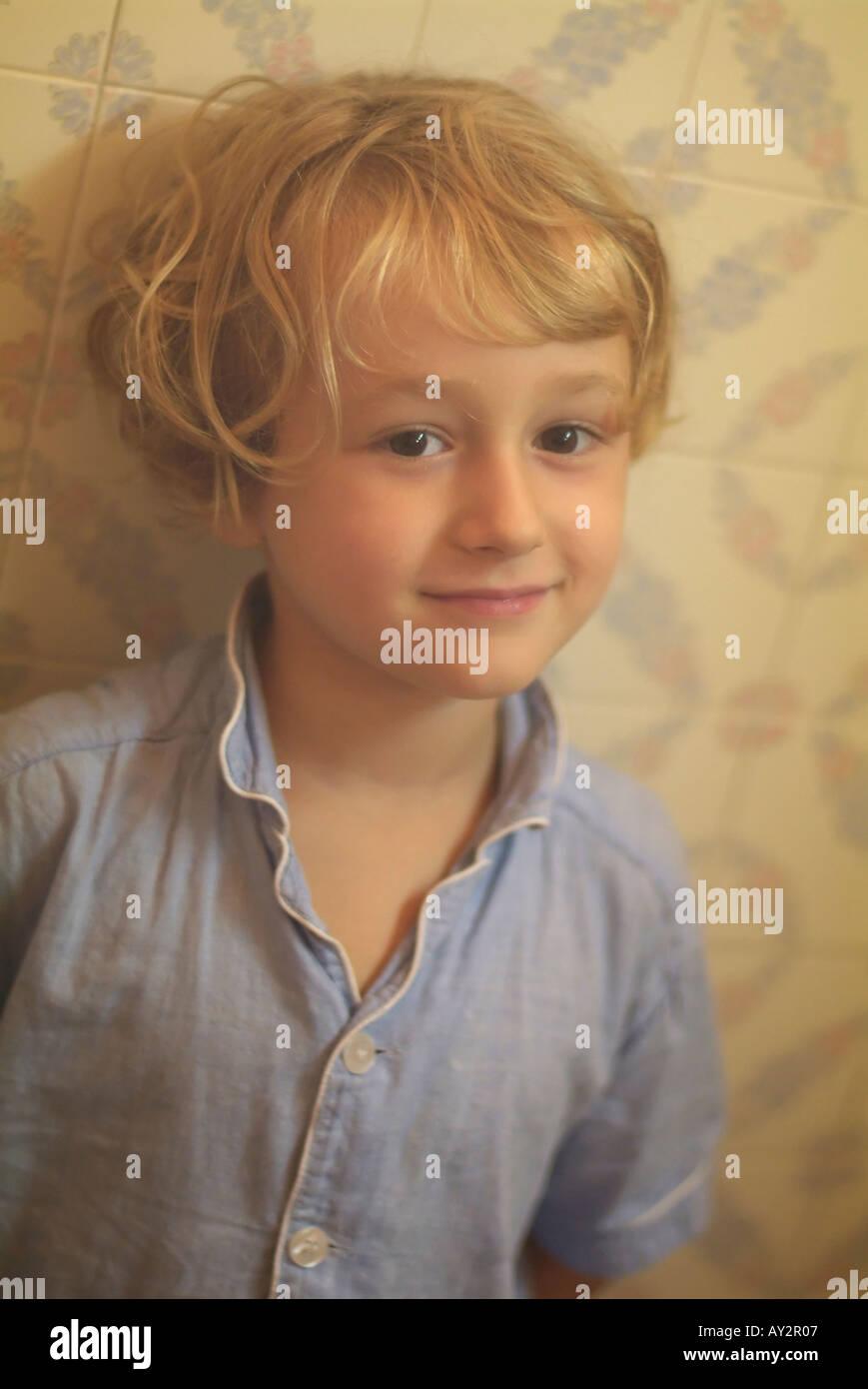 Little girl in a steamy bathroom. Stock Photo