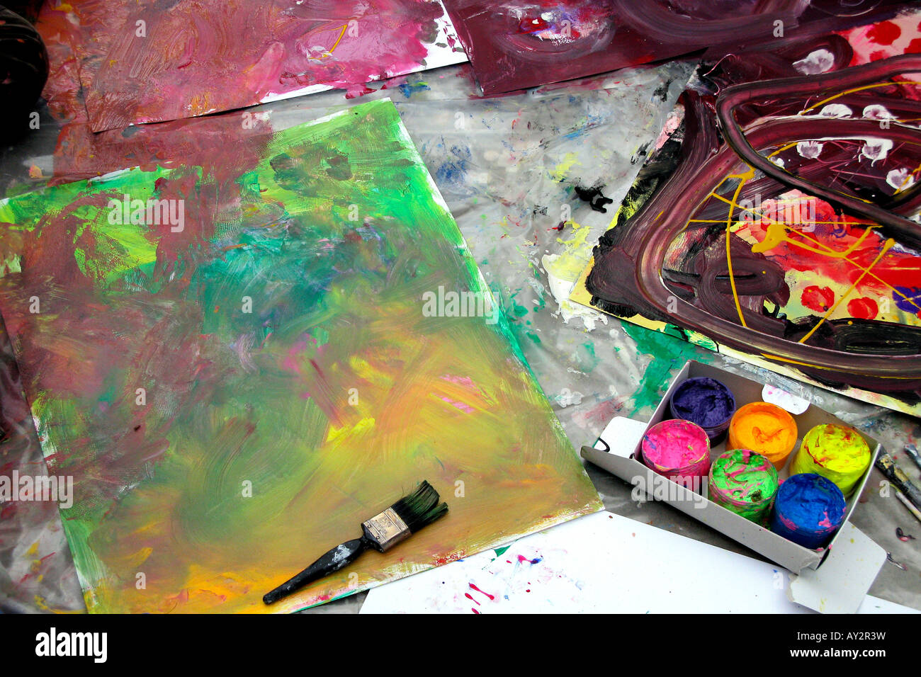 art materials and paintings laying on floor - Stock Image
