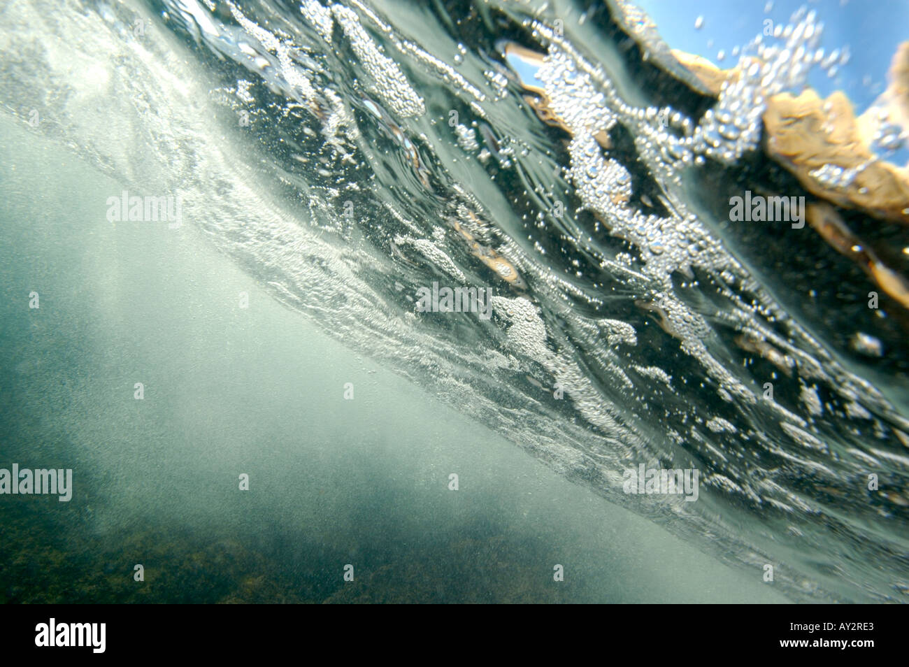 Bubbles under the sea near the surface - Stock Image
