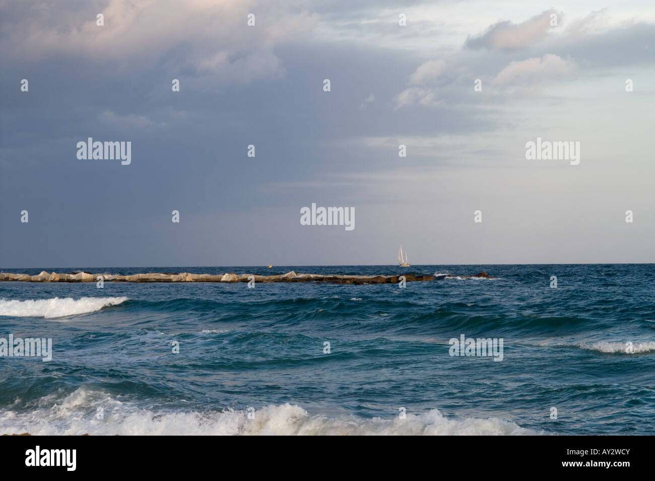 Sailing boat in the Mediterranian sea in Barcelona (Spain) on a winter day - Stock Image