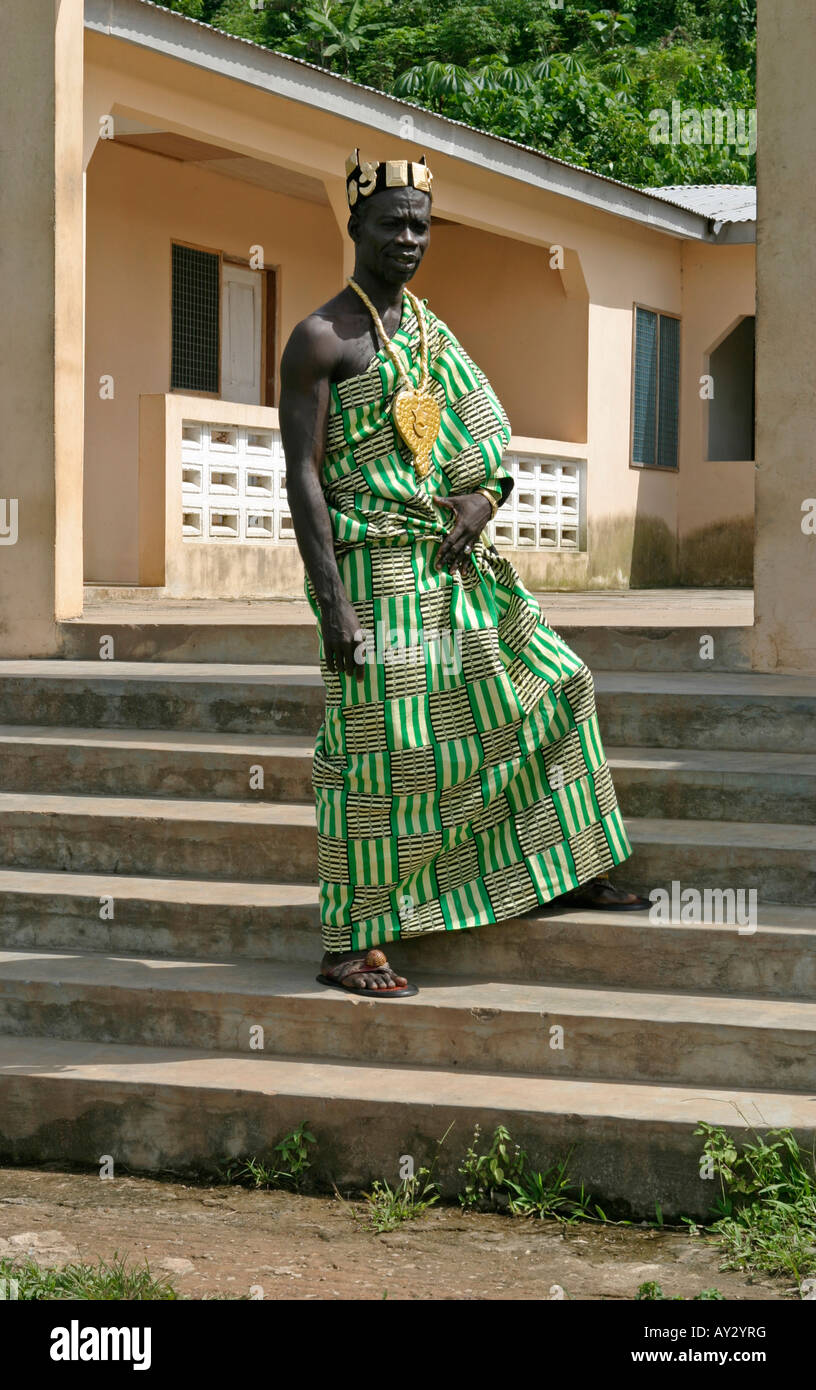 Village African chief outside his palace dressed in ceremonial Kente cloth, Western Ghana - Stock Image