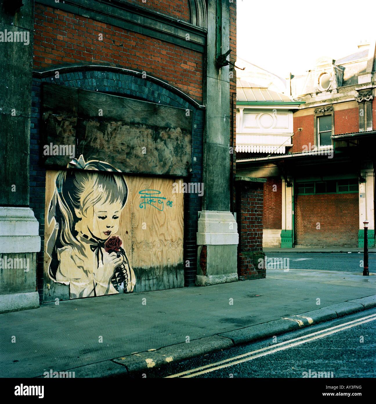Street art in London's Smithfield by the American artist Shepard Fairey - Stock Image