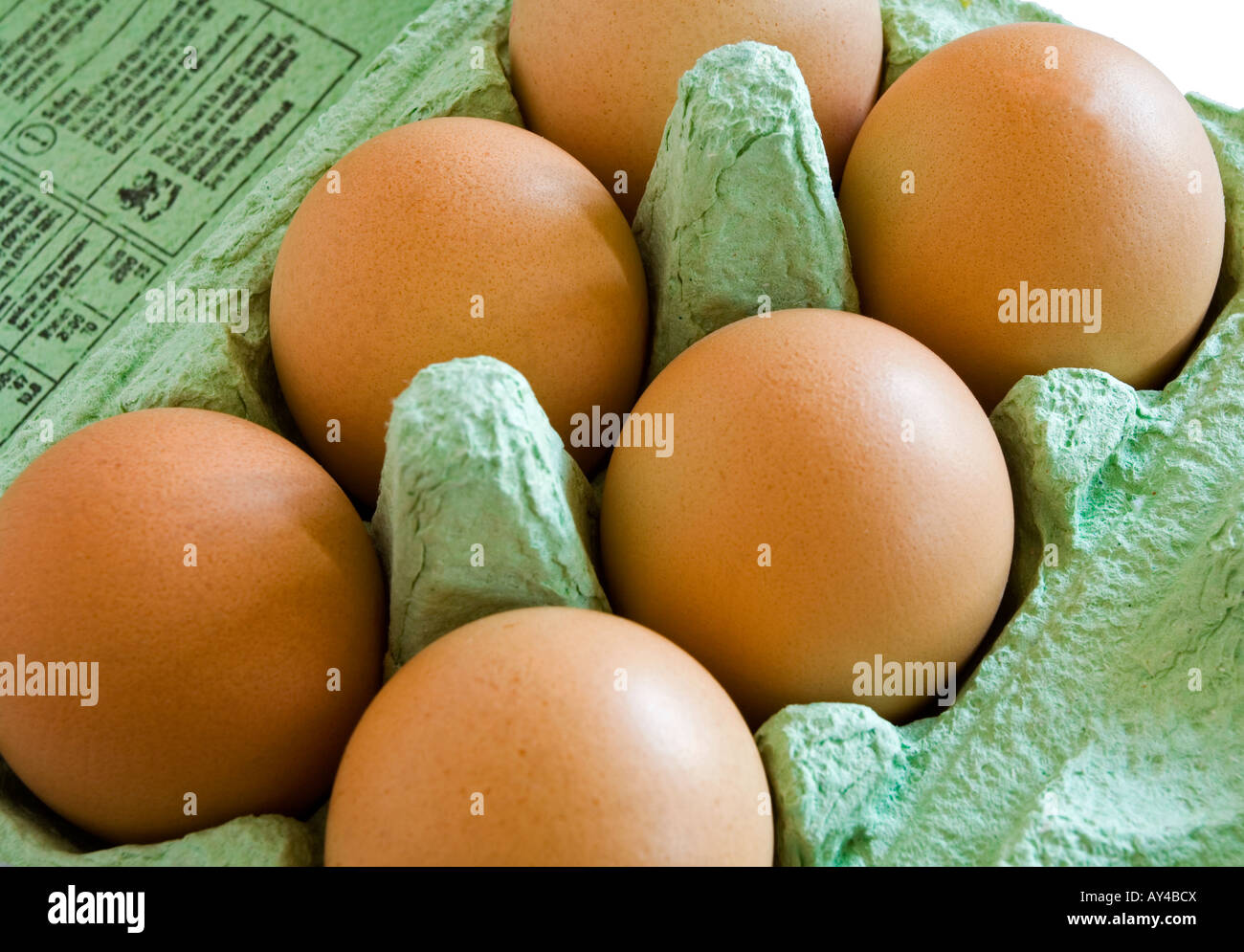 Close up view of free range hen's eggs in a cardboard egg box - Stock Image