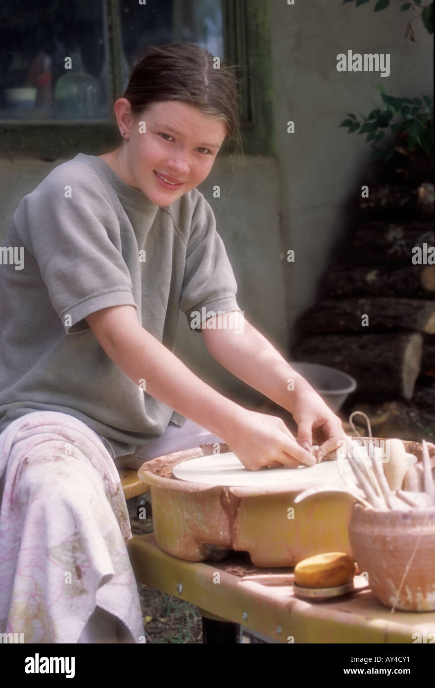 MR 0275 Teen artist Charlotte Pekelsma works with clay on the potter's wheel in Capitan, New Mexico. Stock Photo