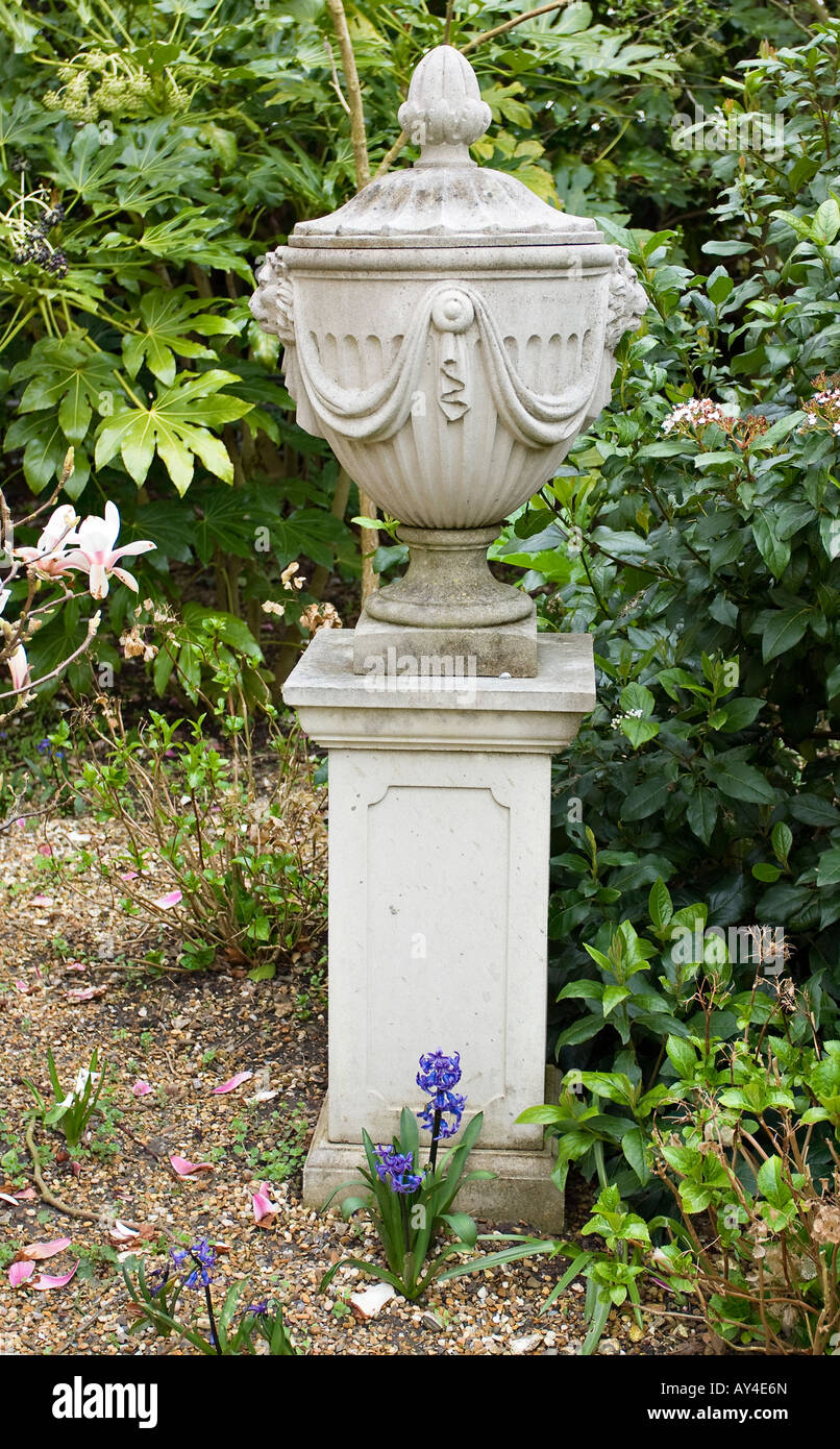 Decorative garden urn on plinth - Stock Image