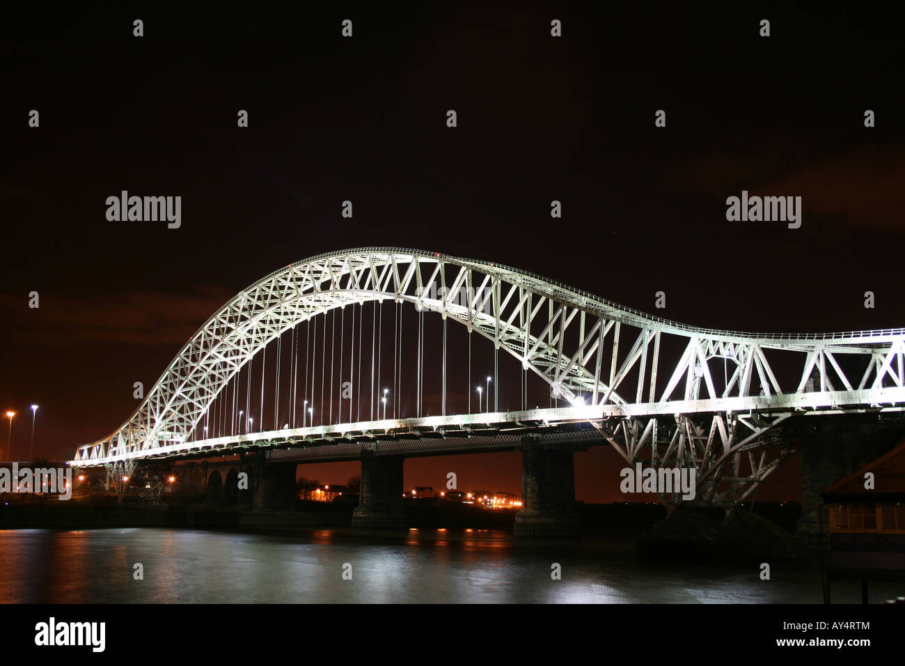 Runcorn Bridge (Silver Jubilee Suspension Bridge) at Night  [A533 Queensway, Runcorn/Widnes, Cheshire, England, - Stock Image