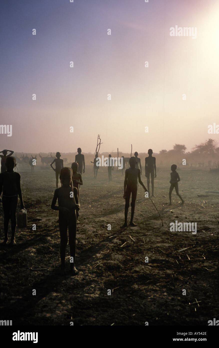 Cattlecamp and crowd of local people in southern Sudan, Africa - Stock Image