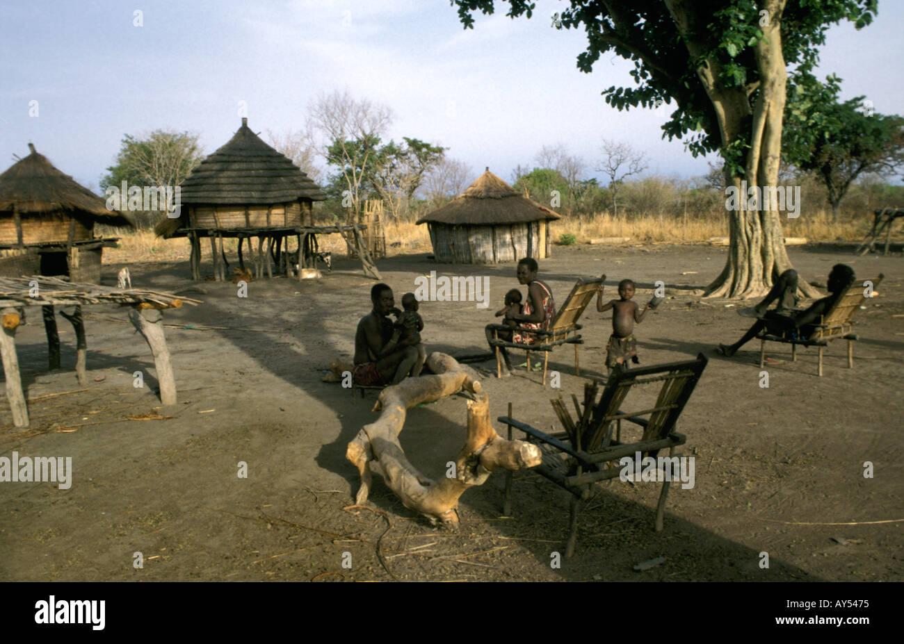 Dinka family having rest - Stock Image