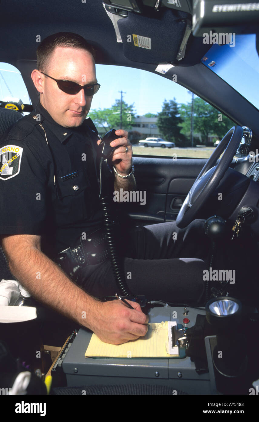 Idaho State Policeman Talking On His Radio In A Police Car Stock